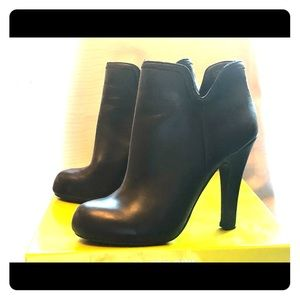 Black leather high heel ankle boots.